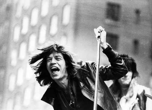 British musician Mick Jagger of the rock band the Rolling Stones performs on a flatbed truck on 5th Avenue as the band announce their 'Tour of the Americas '75,' New York, New York, May 1, 1975. (Photo by Fred W. McDarrah/Getty Images)