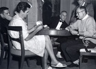 Tony Curtis playing cards with Billy Wilder & George Raft on set 'Some Like It Hot